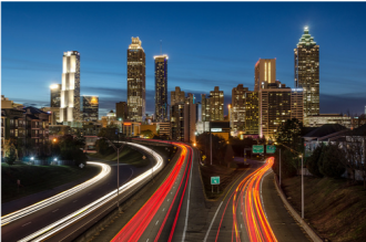 TImelaps of traffic at night in front of downtown Atlanta