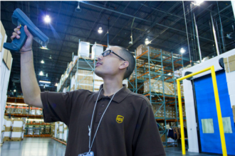 employee scanning in warehouse